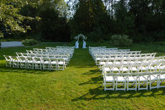 Wedding Venue. Outdoor wedding reception venue set up with white chair Royalty Free Stock Photos