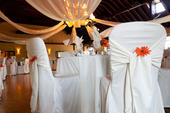 Wedding venue, covered chairs & ceiling decoration Royalty Free Stock Photos