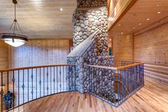 Wedding venue with open floor plan interior. Wedding venue with lovely open floor plan interior. Second floor landing accented with wood paneled walls, ceiling stock images