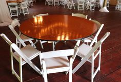 Wedding Venue With Round Tables White Chairs royalty free stock images