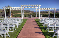 Wedding Venue with White Seats. Wedding venue set up with white folding chairs in wine country Stock Photo