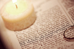 Wedding verse isolated candle. Matthew 19 verse 6 isolated, lit by candle Royalty Free Stock Image