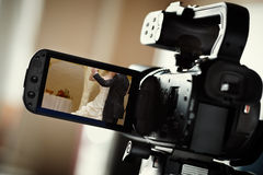 Wedding video. Camcorder, selective focus on screen, wedding dance photo made by me Royalty Free Stock Image