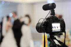 Wedding videography. With dslr camera on tripod stock photo