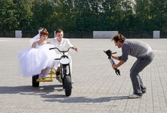 Wedding videooperator. The videooperator films about a newly-married couple on wedding Royalty Free Stock Photography