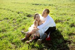 Wedding in village, groom and bride have a fun on a field grass. Country life stock photos