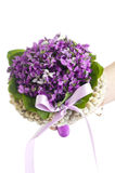 Wedding violet bouquet in the hands of a bride Royalty Free Stock Image