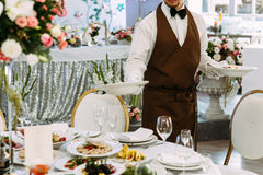 Wedding waiter is serving a table Stock Image