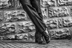 Waiting for the wedding. Wedding waiting shoes bnw groom stock photography