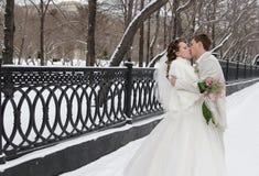 Wedding walk. Bride and groom walking around Novosibirsk, Siberia Royalty Free Stock Photo