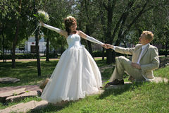 Wedding walk. Bridegroom and bride on walk in park Stock Photography