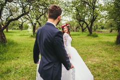 Wedding walk on nature. Bride and groom together Stock Photos
