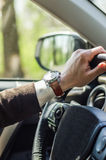 Wedding watch. Bridal car. watch the groom, the groom behind the wheel Stock Photos