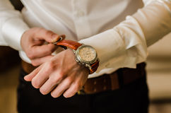 Wedding watch. Wedding groom suit, white shirt, brown pants, watch Stock Photography