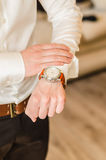Wedding watch. Wedding groom suit, white shirt, brown pants, watch Stock Photos