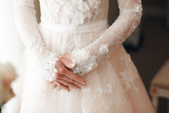 Wedding. Wedding day. Hands of the bride before wedding. Wedding accessories. on the background of the dresses with Royalty Free Stock Photography