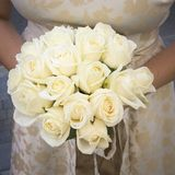 Wedding white bouquet of roses in the hands of the bride Royalty Free Stock Photography