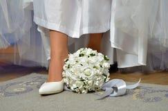 Wedding flowers and white shoe royalty free stock photo