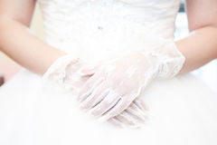 Wedding white lace gloves. A bride wearing white gloves, quietly waiting for the arrival of her husband Royalty Free Stock Images