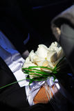 Wedding white rose bouquet in the hands of the groom. Well-dressed man holding a bouquet of flowers, white roses. Holidays and celebrations. Wedding day Stock Photo