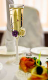 Wedding wine glass. Closeup wuth white drink and roses stock images