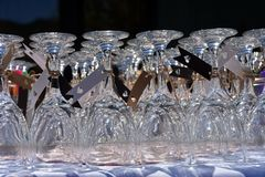 Wedding wine glasses display of wine glasses. Beautiful wine glasses ready for a wedding toast. Glass, crystal, decorated, party glasses stock image