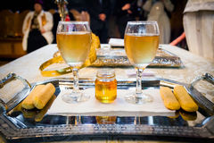 Wedding wine glasses and honey Stock Image