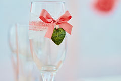 Wedding wineglass in on table in coral color. Wedding ceremony table with decored wineglass in marine style in coral color Royalty Free Stock Photography