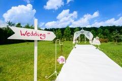 Wedding wooden arrow sign Royalty Free Stock Photos