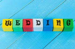 Wedding - word on children's colourful cubes or Stock Photography