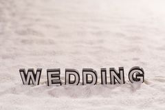 Wedding word on white sand Royalty Free Stock Photography