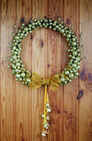 The wedding wreath hangs on a  wall Royalty Free Stock Photography