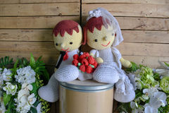 Wedding yarn doll with white flower Stock Photo