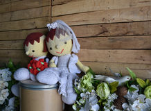 Wedding yarn doll with white flower Stock Images