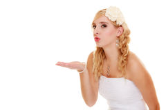 Wedding. Young woman romantic bride blowing a kiss Royalty Free Stock Images