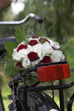 Weddingbouquet on the bike Royalty Free Stock Image