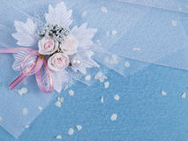 Weddings accessorie a buttonhole  and petals Royalty Free Stock Image