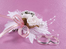 Weddings accessories are a buttonhole and rings Stock Photo