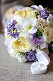 Weddings bouquet and golden rings. Festive wedding bouquet with two golden rings in a box Royalty Free Stock Image