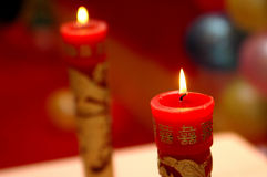 Weddings candles. A happy chinese weddings with the red weddings's candles Stock Photos