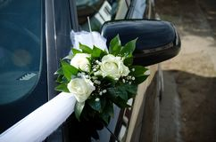 Weddings ditail. Yellow roses as decoration on car for weeding Stock Image