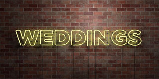 WEDDINGS - fluorescent Neon tube Sign on brickwork - Front view - 3D rendered royalty free stock picture Royalty Free Stock Images