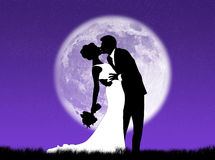 Weddings in the moon. Bride and groom kissing in the moon Stock Photography