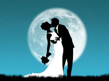 Weddings in the moon. Bride and groom kissing in the moon Royalty Free Stock Photography