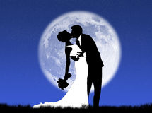 Weddings in the moon. Bride and groom kissing in the moon Stock Photo