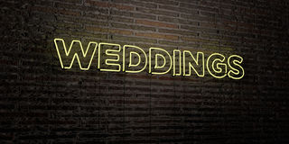 WEDDINGS -Realistic Neon Sign on Brick Wall background - 3D rendered royalty free stock image Royalty Free Stock Image