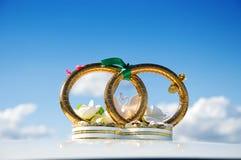 Weddings rings. Golden weddings rings over car Stock Photography