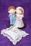 Weddings rings and the couple. Two weddings rings and the wedding couple Royalty Free Stock Photos