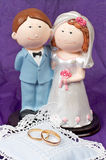 Weddings rings and the couple. Two weddings rings and the wedding couple Royalty Free Stock Images
