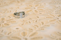 Weddings  rings on a luxury bed. Stock Images
